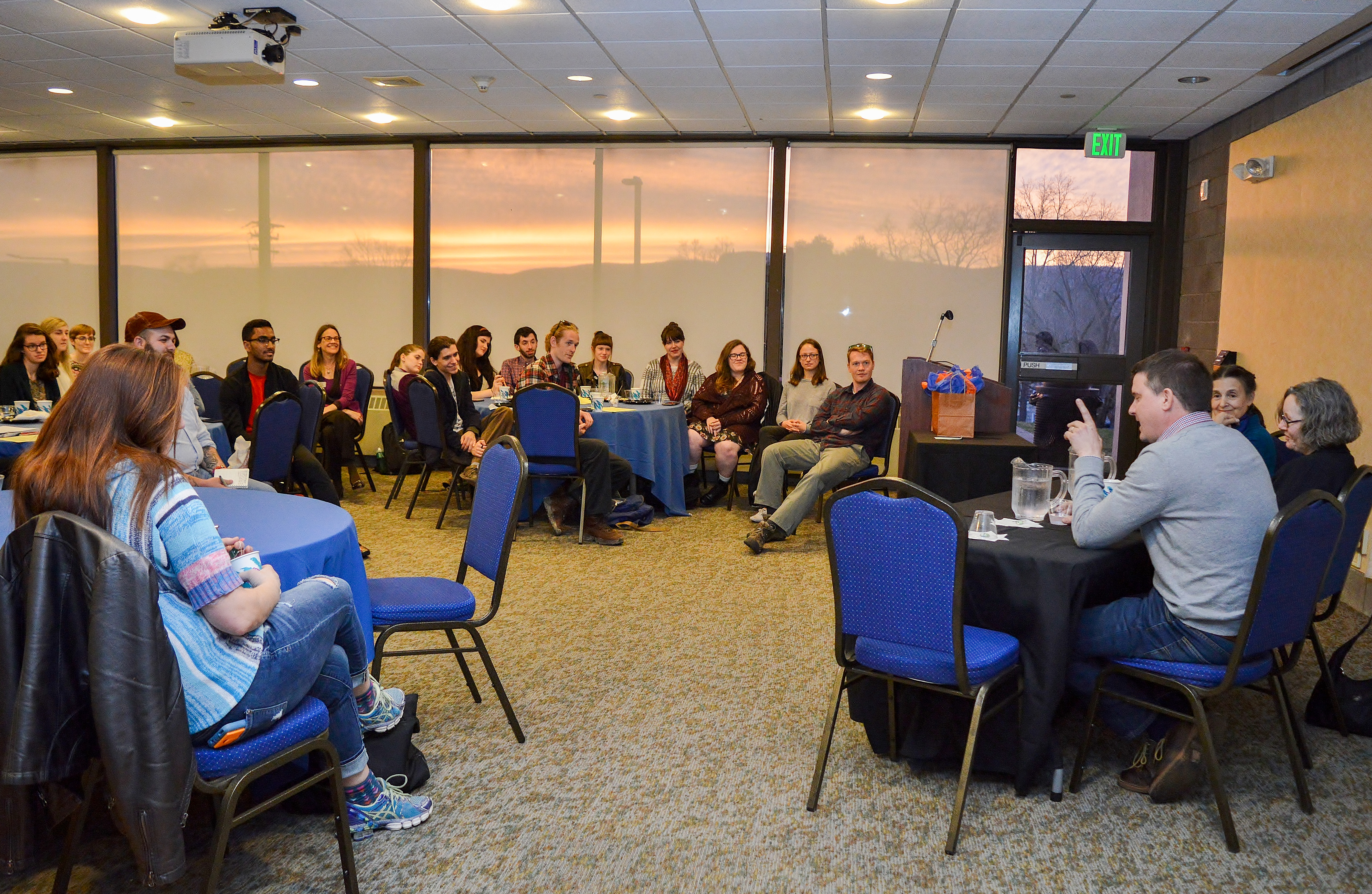 A beautiful sunset is the backdrop for a wonder evening discussion by alumni about career paths for art history majors