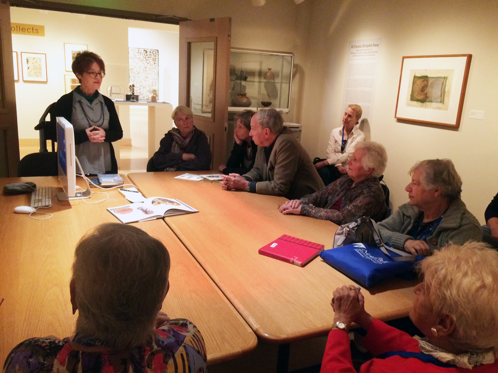 Prof. Elizabeth Brotherton speaks to a group of alumni who studied art history with Prof. Hugo Munsterberg in the 60s and 70s.