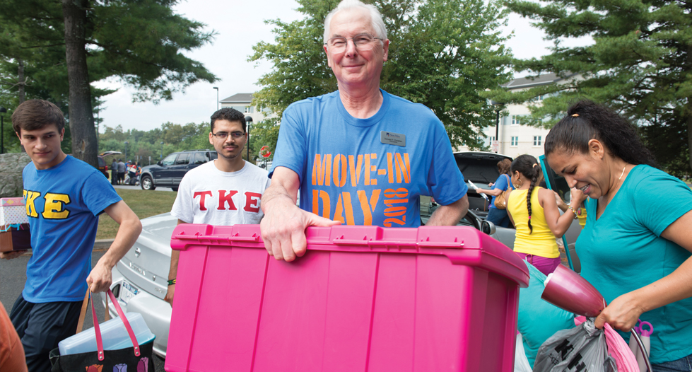 President Christian helping students move into their dorms
