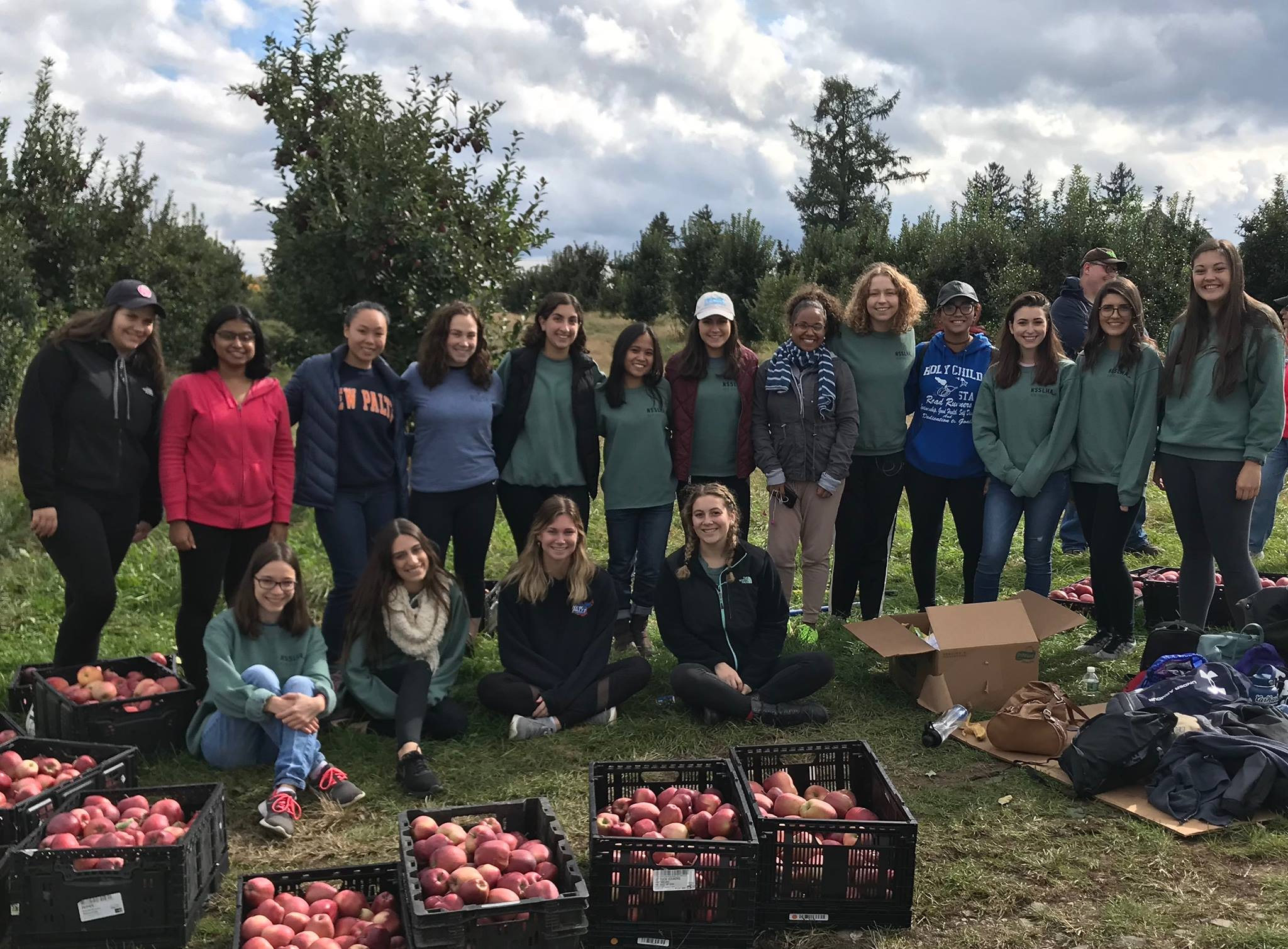 NSSLHA members with apples picked on Make a Difference Day