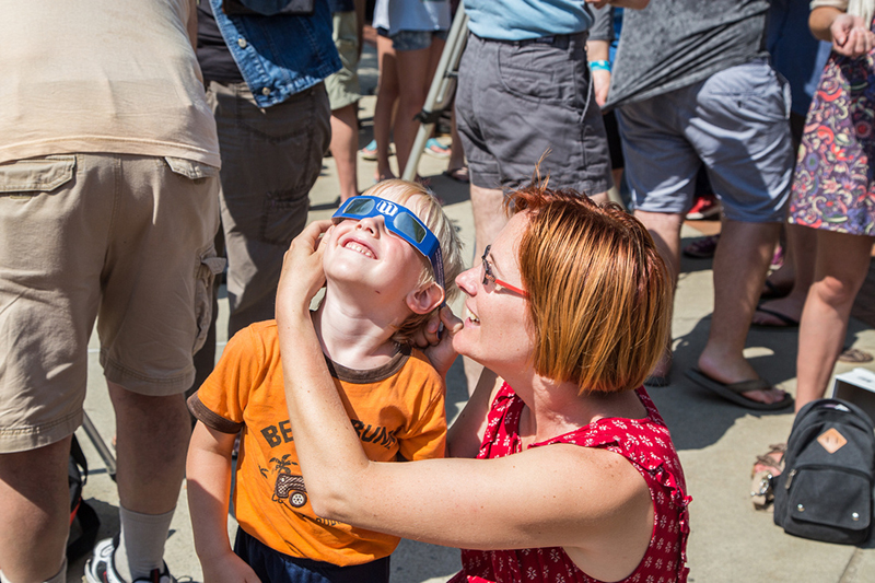 Mother and child at the Solar Eclipse on Campus