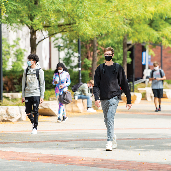 masked students on campus