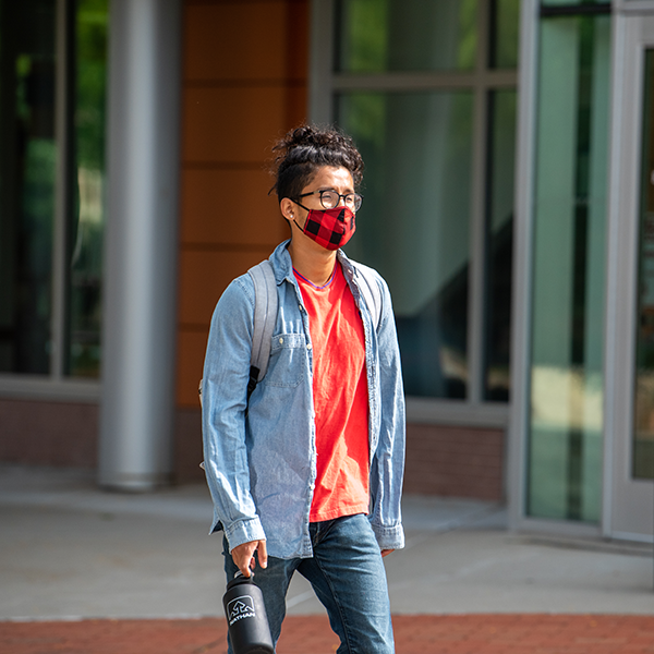 masked student on campus
