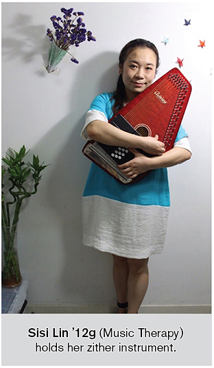 Sisi Lin holds her autoharp