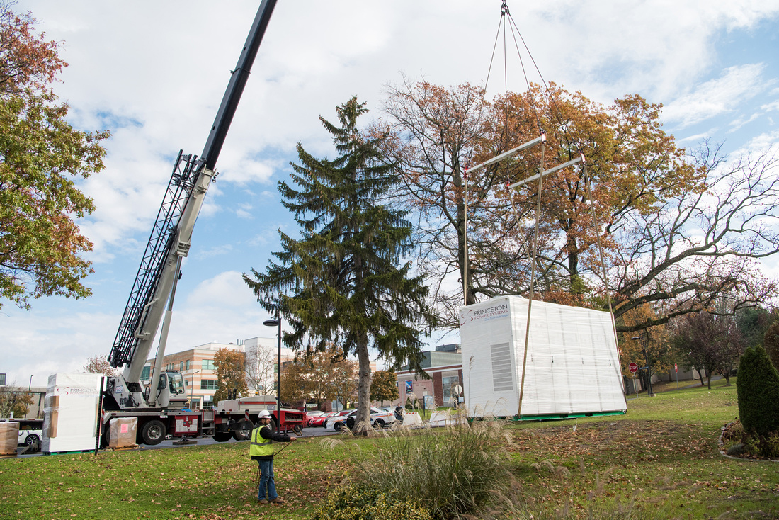 crane delivering battery to campus