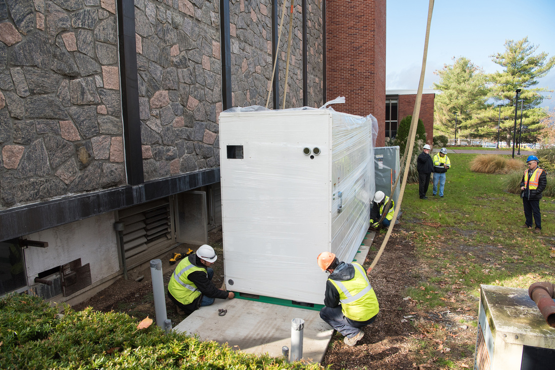 solar battery being installed on the side of Elting Gymnasium