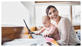woman with child at a computer