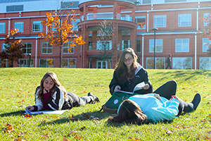 Students reading in front of Wooster Hall