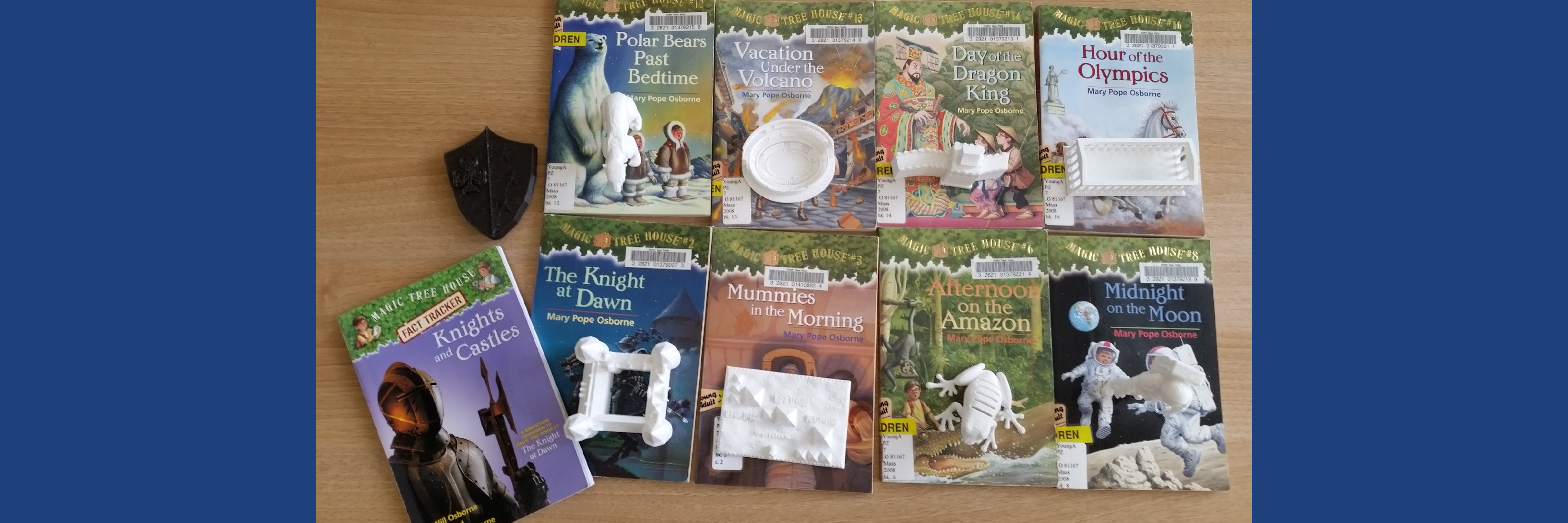 Magic Tree House books with 3D printed models of an object in the book