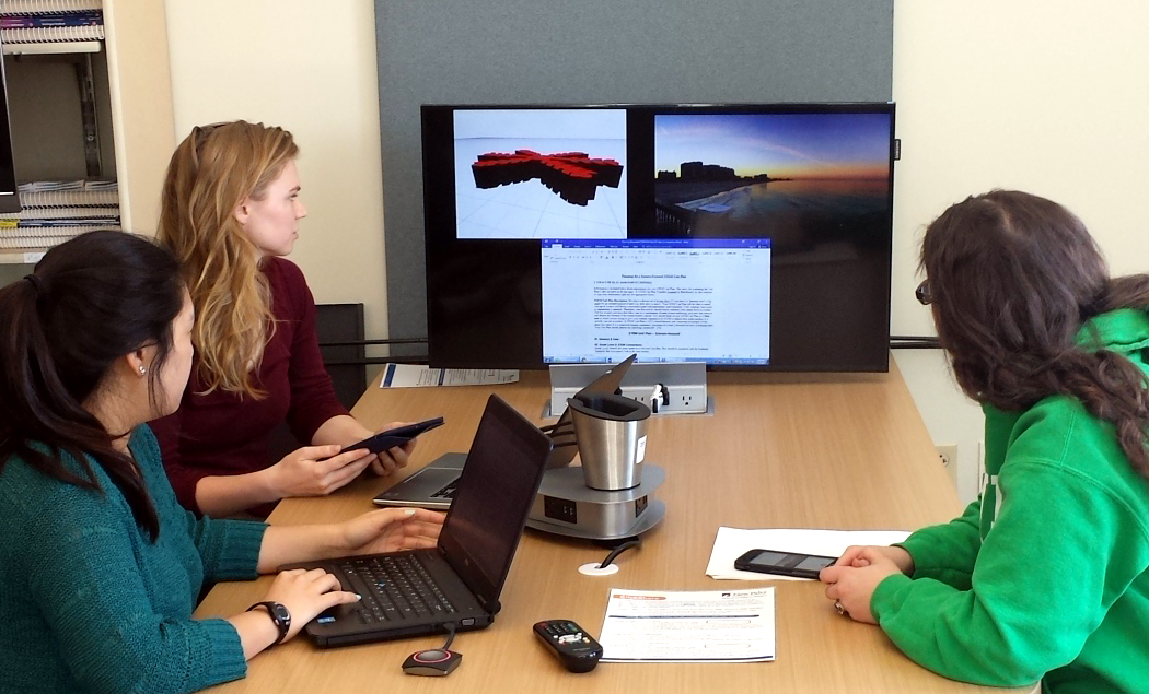 Scene of three students using the ClickShare TV