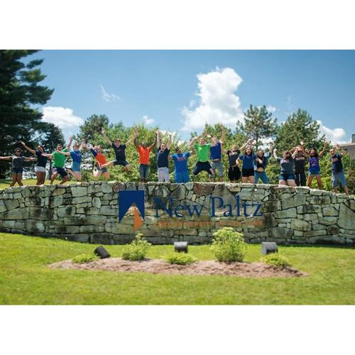 New Paltz stone wall and students