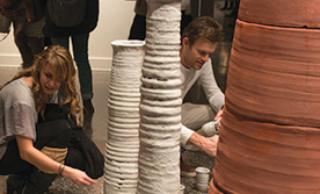 Students looking at sculpture installation